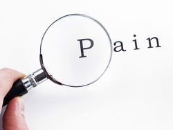 "Magnifying glass over word ""pain"""